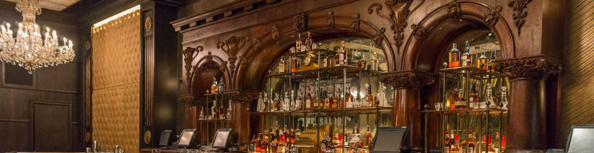Photo of a bar with custom wood millwork.