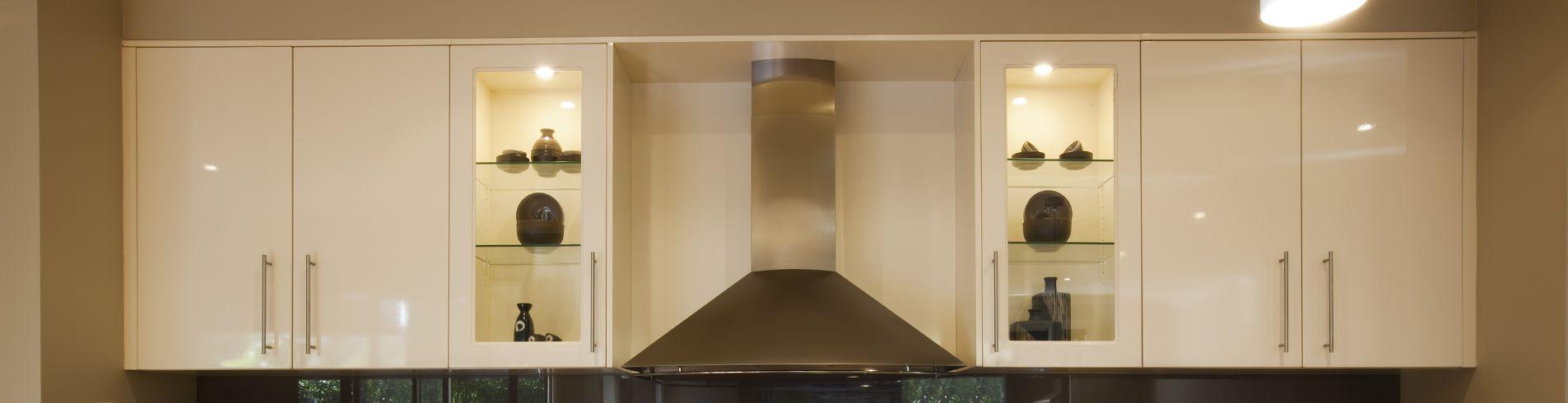 Photo of custom white kitchen cabinets.